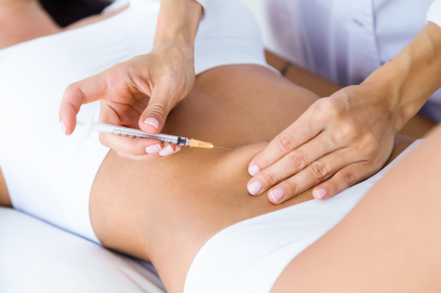 surgeon-making-injection-into-female-body-liposuction-concept_1301-7783